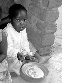 Child eating a provided CFF meal